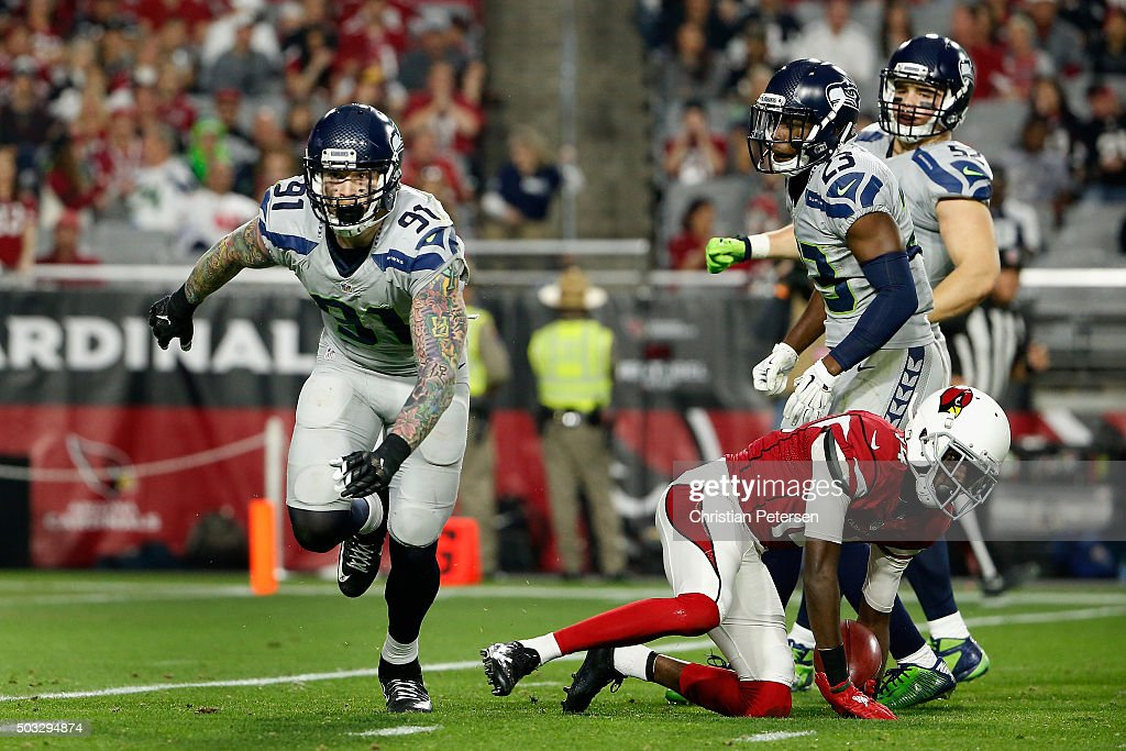 Defensive end Cassius Marsh #91 of the Seattle Seahawks celebrates after tackling wide receiver J.J. Nelson #14 of the Arizona Cardinals during the NFL game at the University of Phoenix Stadium on January 3, 2016 in Glendale, Arizona. The Seahawks defeated the Cardinals 36-6.