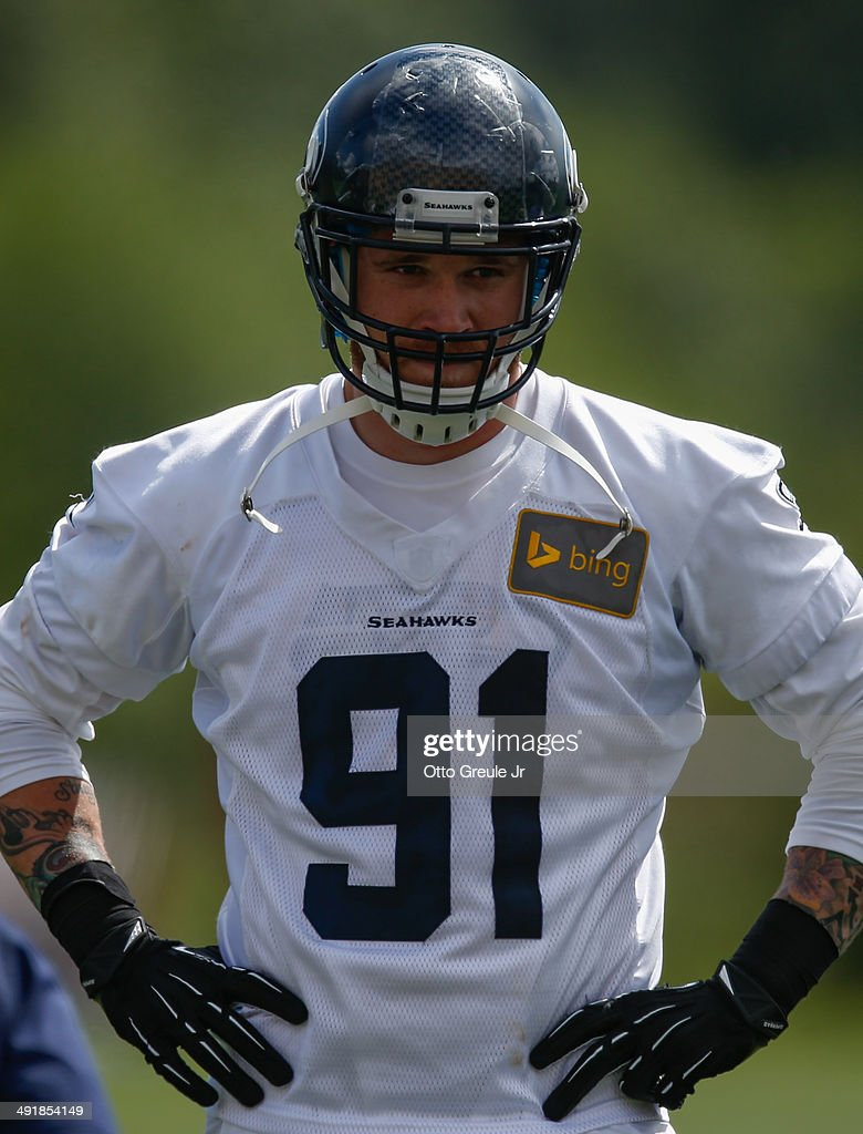 Defensive end Cassius Marsh #91 of the Seattle Seahawks looks on during Rookie Minicamp at the Virginia Mason Athletic Center on May 17, 2014 in Renton, Washington.