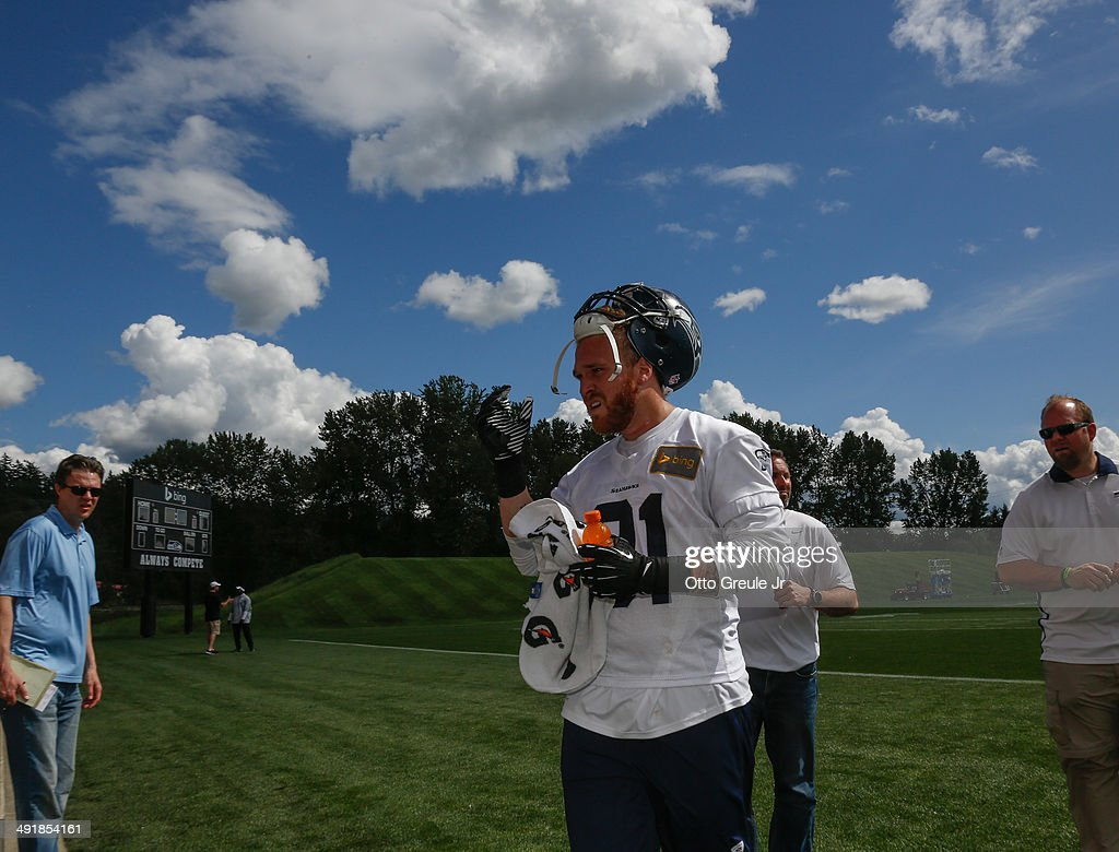Defensive end Cassius Marsh #91 of the Seattle Seahawks walks off the field after Rookie Minicamp at the Virginia Mason Athletic Center on May 17, 2014 in Renton, Washington.