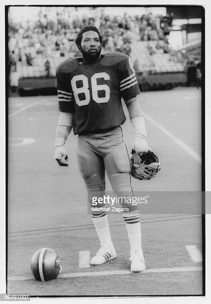 Defensive end Cedrick Hardman of the San Francisco 49ers stands on the field during the game against the Chicago Bears on November 16 1975 at...