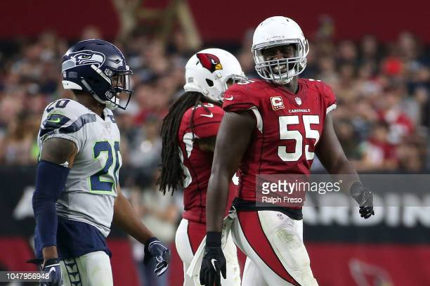 Defensive end Chandler Jones of the Arizona Cardinals talks to running back Rashaad Penny of the Seattle Seahawks during an NFL game at State Farm...