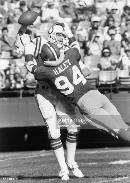 Defensive end Charles Haley of the San Francisco 49ers sacks quarterback Jack Trudeau of the Indianapolis Colts at Candlestick Park on October 5,...