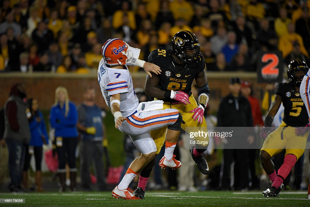 Defensive end Charles Harris #91 of the Missouri Tigers puts a hit on Will Grier #7 of the Florida Gators at Memorial Stadium on October 10, 2015 in Columbia, Missouri.