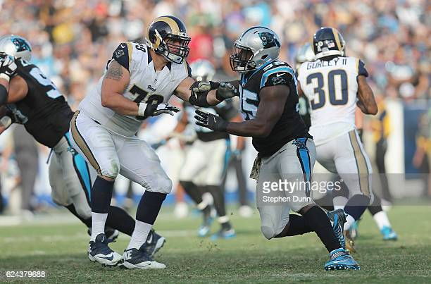 Defensive end Charles Johnson of the Carolina Panthers and offensive tackle Robert Havenstein of the Los Angeles Rams battle at the line of scrimmage...