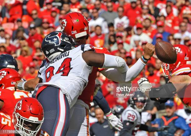 Defensive end Charles Omenihu of the Houston Texans hit on quarterback Patrick Mahomes of the Kansas City Chiefs causes a fumble during the second...