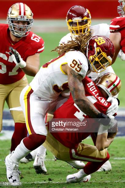 Defensive end Chase Young of the Washington Football Team sacks quarterback Nick Mullens of the San Francisco 49ers during the first quarter of the...