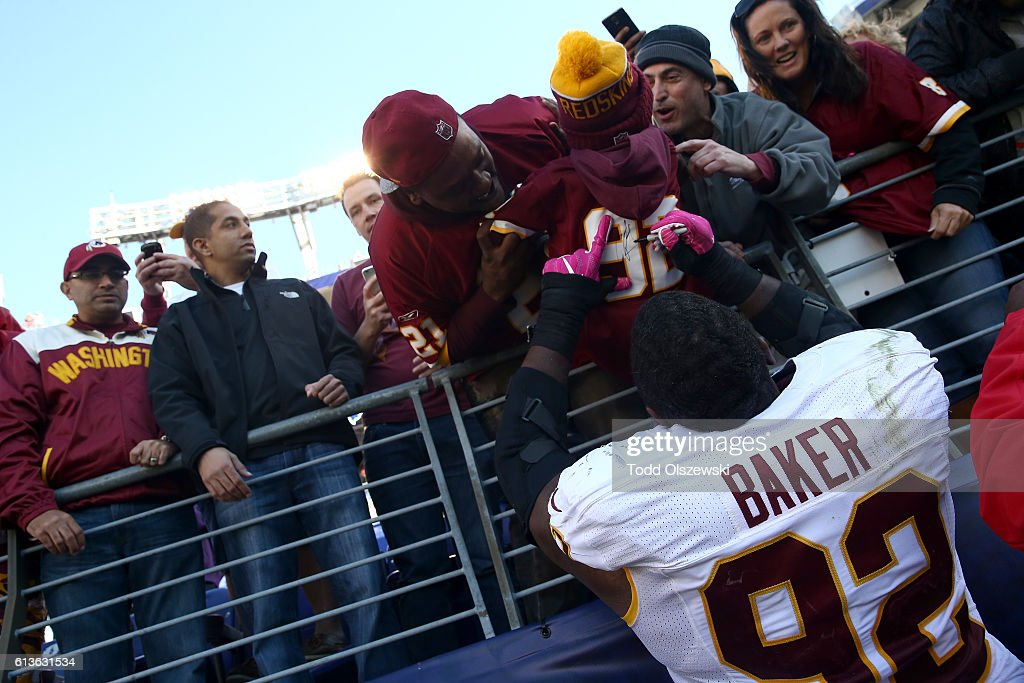 Defensive end Chris Baker #92 of the Washington Redskins autographs a jersey for a fan after the game against the Baltimore Ravens at M&T Bank Stadium on October 9, 2016 in Baltimore, Maryland.