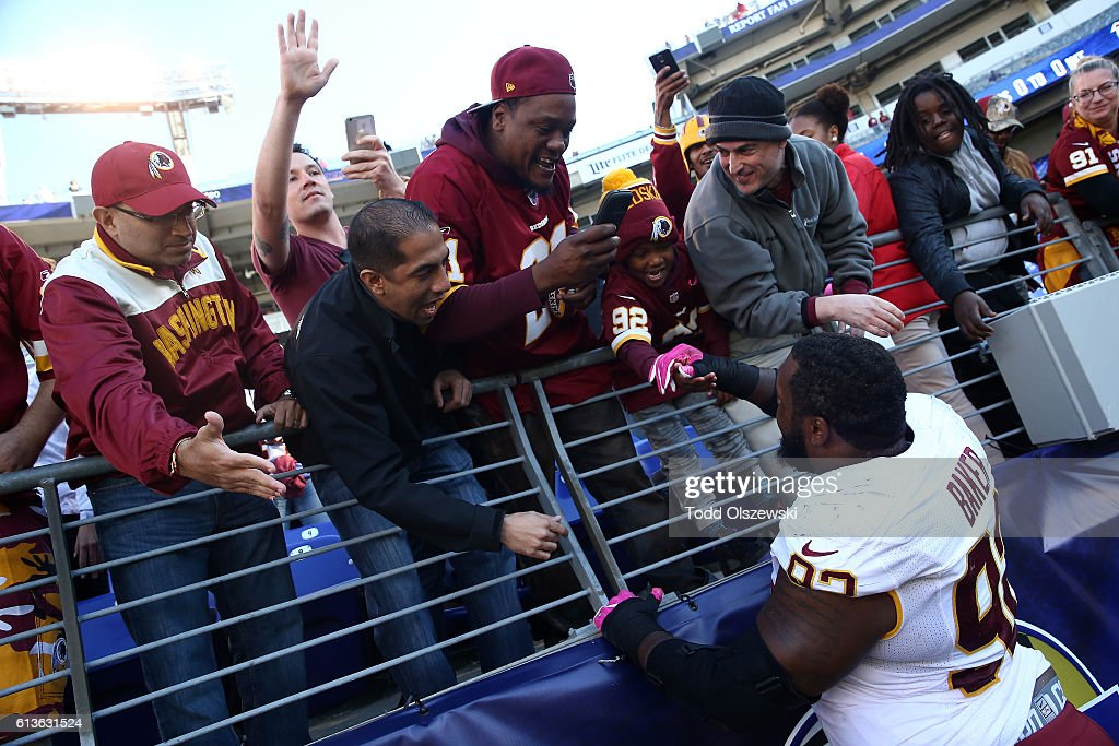 Defensive end Chris Baker #92 of the Washington Redskins celebrates with fans post game at M&T Bank Stadium on October 9, 2016 in Baltimore, Maryland.