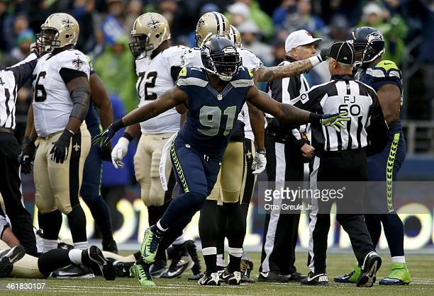 Defensive end Chris Clemons of the Seattle Seahawks celebrates after the Seahawks recover a fumble in the second quarter by running back Mark Ingram...