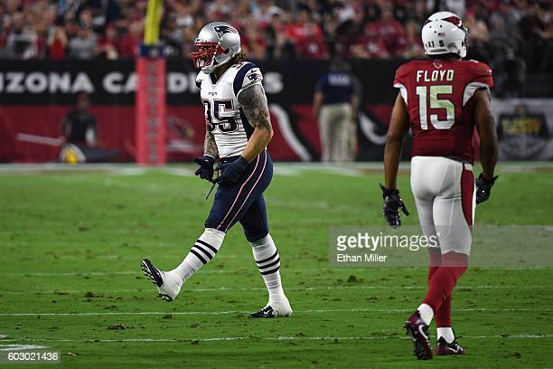 Defensive end Chris Long of the New England Patriots reacts after a sack against the Arizona Cardinals during the NFL game at University of Phoenix...