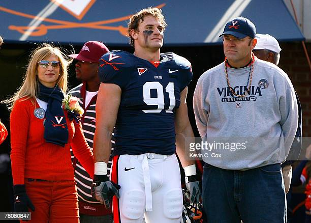 Defensive end Chris Long of the Virginia Cavaliers stands with his mother Diane and his father and Pro Football Hall of Famer Howie Long before...