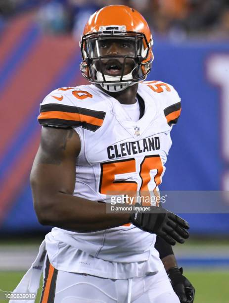 Defensive end Chris Smith of the Cleveland Browns walks off the field in the fourth quarter of a preseason game against the New York Giants at...