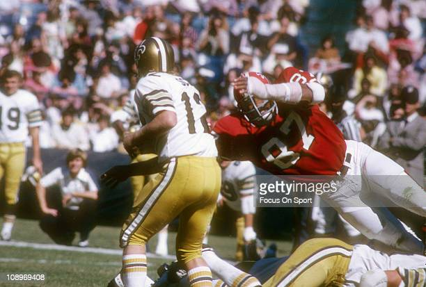 Defensive end Claude Humphrey of the Atlanta Falcons dives at quarterback Bobby Scott of the New Orleans Saints during an NFL football game at...