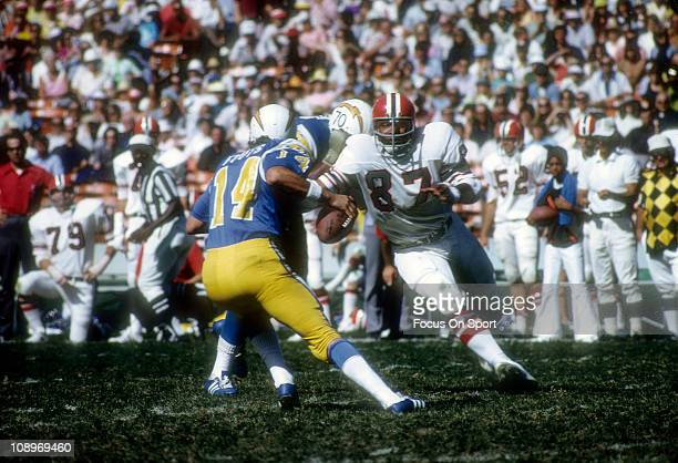 Defensive end Claude Humphrey of the Atlanta Falcons pursues quarterback Dan Fouts of the San Diego Chargers during an NFL football game at Jack...