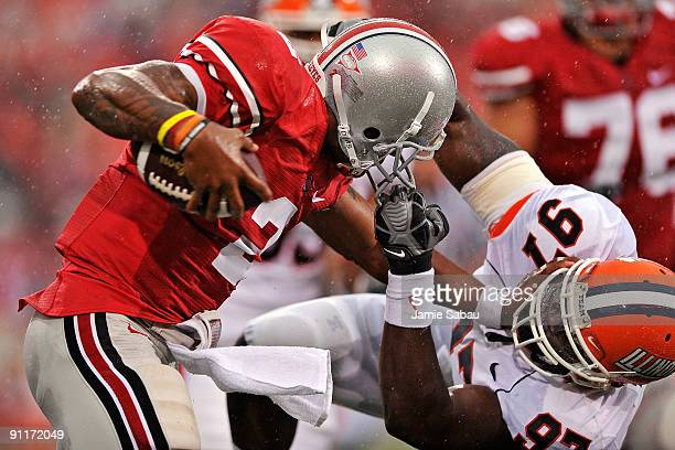 Defensive end Clay Nurse of the Illinois Fighting Illini hauls down quarterback Terrelle Pryor of the Ohio State Buckeyes by his facemask at Ohio...