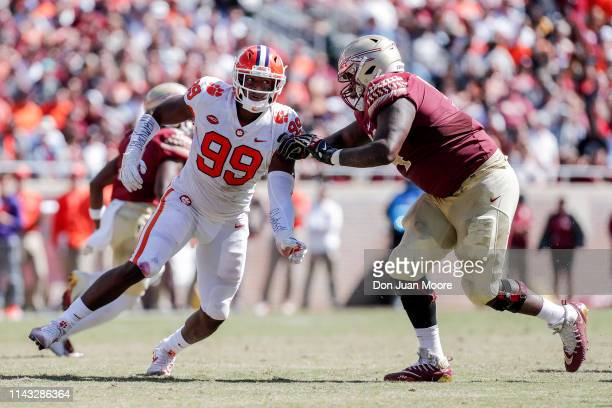 Defensive End Clelin Ferrell of the Clemson Tigers is defended by Tackle Derrick Kelly of the Florida State Seminoles during the game at Doak...