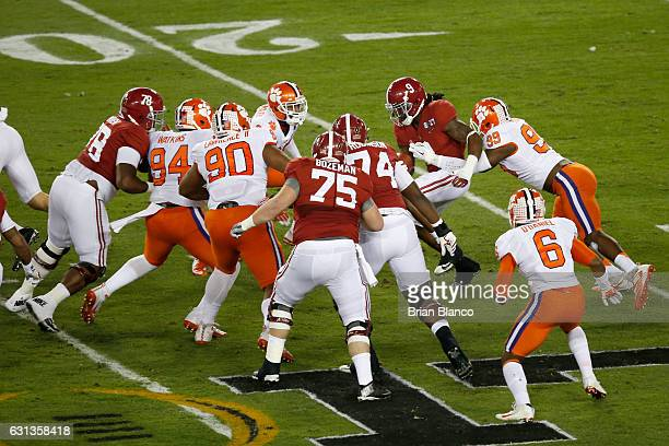 Defensive end Clelin Ferrell of the Clemson Tigers tackles running back Bo Scarbrough of the Alabama Crimson Tide in the first quarter in the 2017...