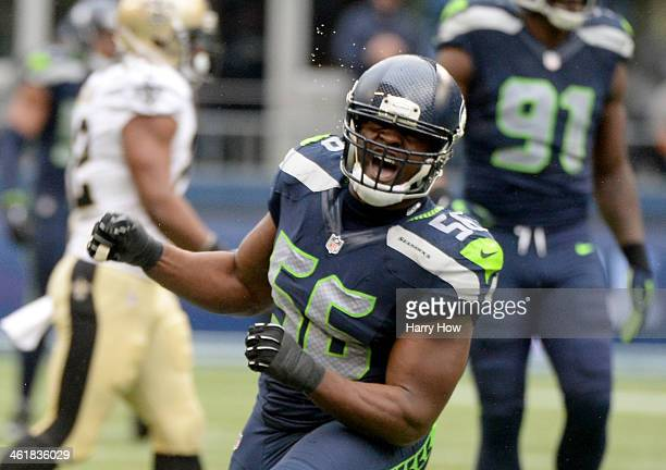 Defensive end Cliff Avril of the Seattle Seahawks celebrates after stopping the New Orleans Saints in the third quarter during the NFC Divisional...