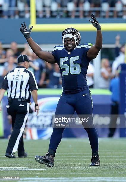 Defensive end Cliff Avril of the Seattle Seahawks celebrates against the Denver Broncos at CenturyLink Field on September 21 2014 in Seattle...