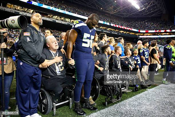 Defensive end Cliff Avril of the Seattle Seahawks is seen during opening ceremonies before a game against the Buffalo Bills at CenturyLink Field on...