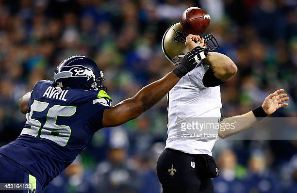 Defensive end Cliff Avril of the Seattle Seahawks knocks the ball from quarterback Drew Brees of the New Orleans Saints in the first quarter during a...