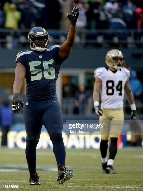 Defensive end Cliff Avril of the Seattle Seahawks reacts in the third quarter in front of wide receiver Kenny Stills of the New Orleans Saints during...