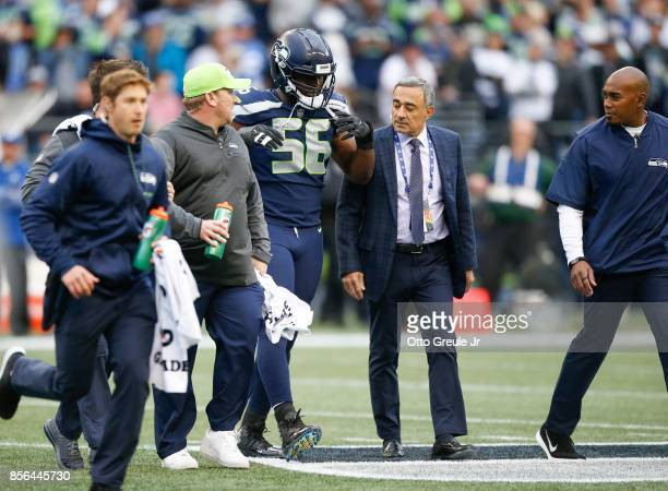 Defensive end Cliff Avril of the Seattle Seahawks walks off the field after being checked on by training staff in the first quarter of the game...