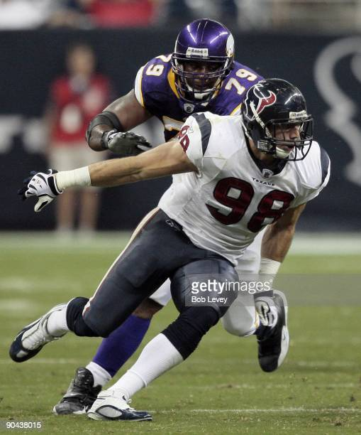 Defensive end Connor Barwin of the Houston Texans goes around guard Artis Hicks of the Minnesota Vikings at Reliant Stadium on August 31 2009 in...