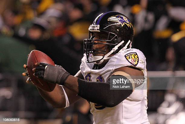 Defensive end Cory Redding of the Baltimore Ravens celebrates after scoring on a fumble by the Pittsburgh Steelers during the AFC Divisional Playoff...