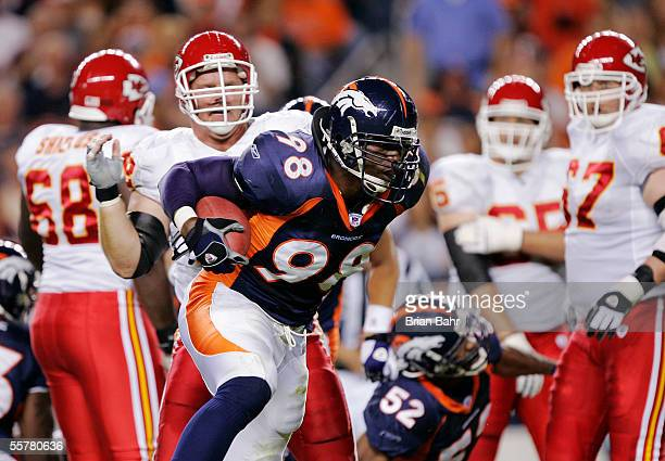 Defensive end Courtney Brown of the Denver Broncos comes up with the ball on a run by Larry Johnson of the Kansas City Chiefs at the 12-yard line in...