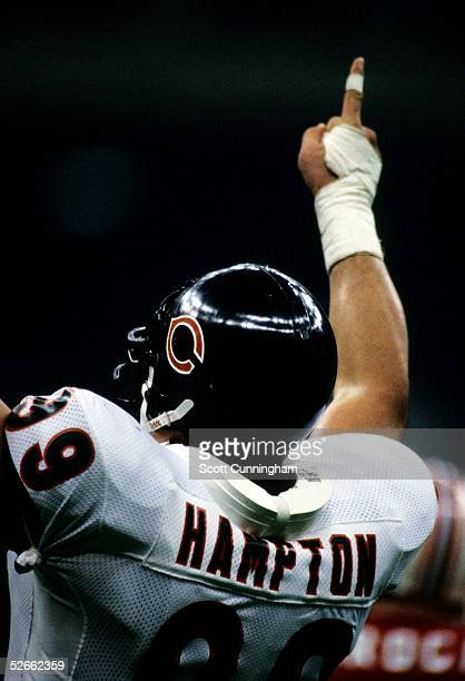 Defensive End Dan Hampton of the Chicago Bears celebrates after winning Super Bowl XX against the New England Patriots at the Louisiana Superdome on...