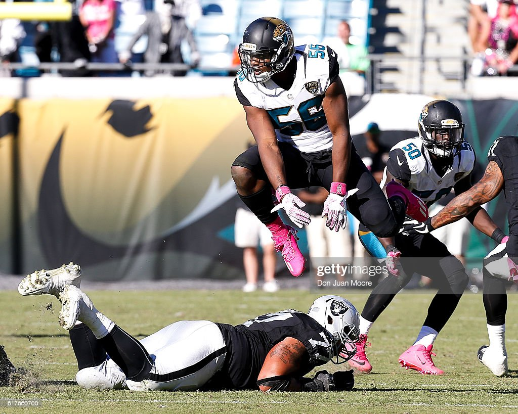 Defensive End Dante Fowler Jr. #56 of the Jacksonville Jaguars avoids a low block by leaping over Tackle Austin Howard #77 of the Oakland Raiders during the game at EverBank Field on October 23, 2016 in Jacksonville, Florida. The Raiders defeated the Jaguars 33 to 16.