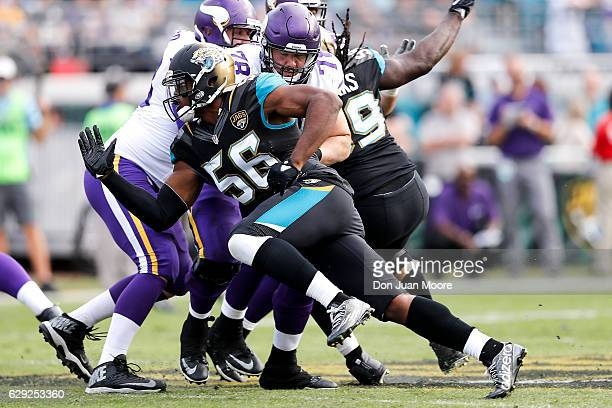 Defensive End Dante Fowler Jr #56 of the Jacksonville Jaguars blows past Tackle Jeremiah Sirles of the Minnesota Vikings during the game at EverBank...