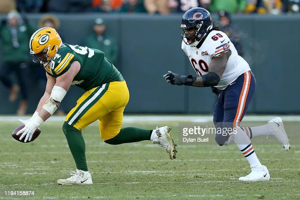 Defensive end Dean Lowry of the Green Bay Packers catches an intercepts over offensive guard Rashaad Coward of the Chicago Bears during the game at...