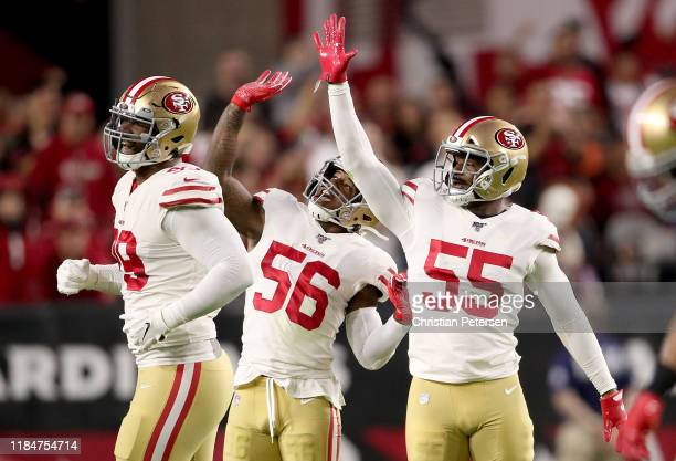 Defensive end Dee Ford middle linebacker Kwon Alexander and defensive tackle DeForest Buckner of the San Francisco 49ers celebrate a sack during the...