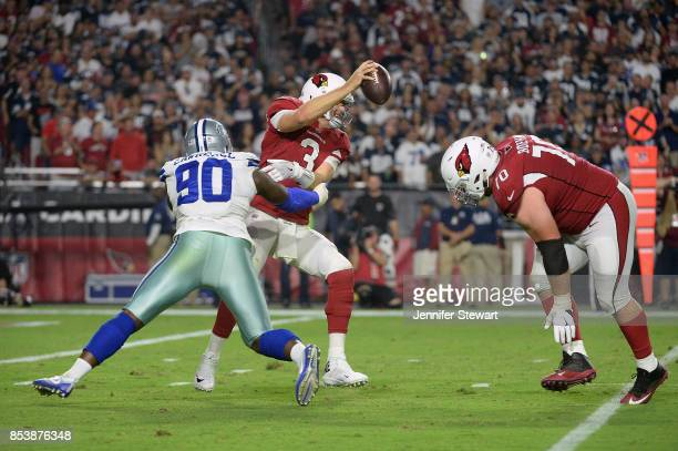 Defensive end Demarcus Lawrence of the Dallas Cowboys hits quarterback Carson Palmer of the Arizona Cardinals during the second half of the NFL game...
