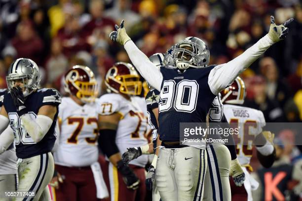 Defensive end Demarcus Lawrence of the Dallas Cowboys reacts after a play in the fourth quarter against the Washington Redskins at FedExField on...