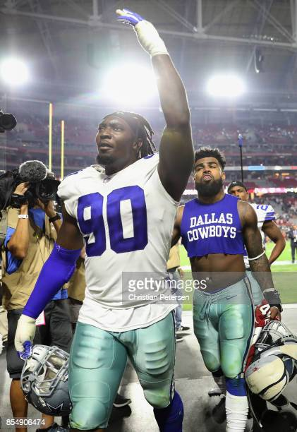 Defensive end Demarcus Lawrence of the Dallas Cowboys walks off the field following the NFL game against the Arizona Cardinals at the University of...