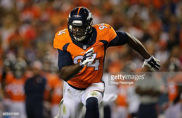 Defensive end DeMarcus Ware of the Denver Broncos rushes against the Seattle Seahawks during preseason action at Sports Authority Field at Mile High...