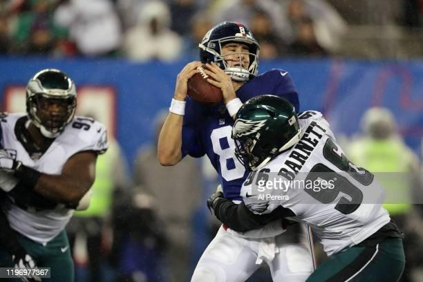 Defensive End Derek Barnett of the Philadelphia Eagles Sacks Quarterback Daniel Jones of the New York Giants in the rain in the second half at...