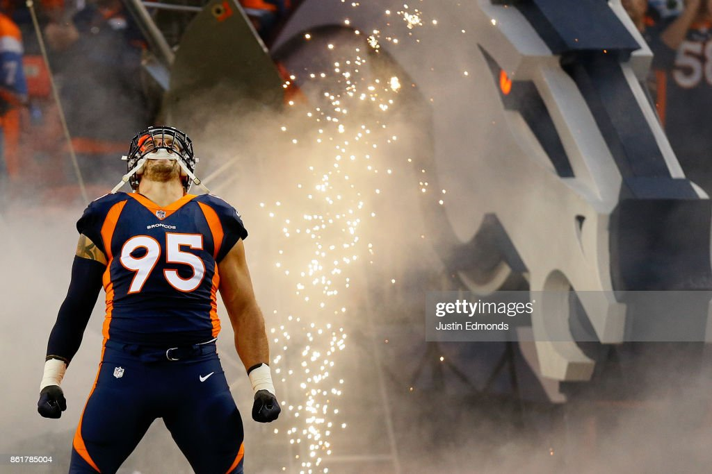 Defensive end Derek Wolfe #95 of the Denver Broncos is introduced to the crowd before a game against the New York Giants at Sports Authority Field at Mile High on October 15, 2017 in Denver, Colorado.