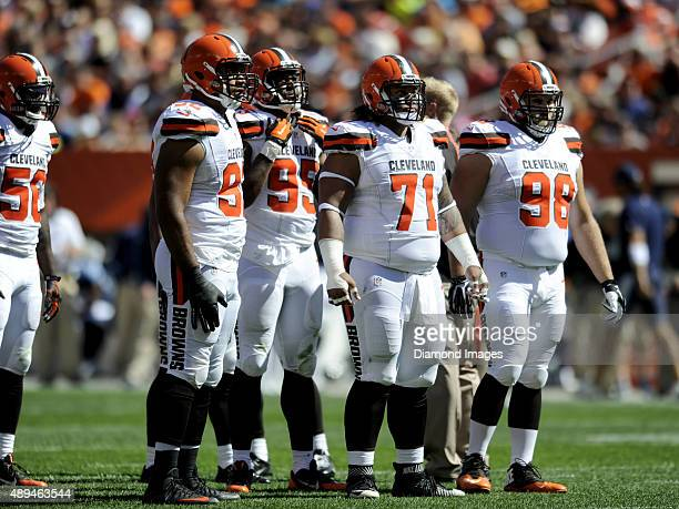 Defensive end Desmond Bryant defensive end Armonty Bryant defensive tackle Danny Shelton and defensive tackle Jamie Meder stand at the line of...