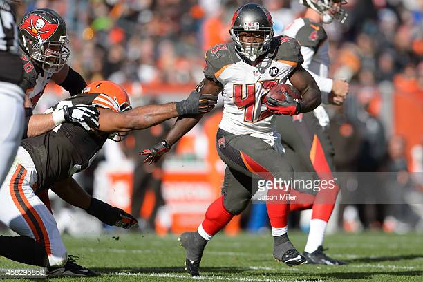 Defensive end Desmond Bryant of the Cleveland Browns tries to tackle running back Bobby Rainey of the Tampa Bay Buccaneers during the first half at...