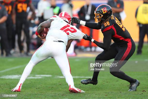 Defensive End Devin Taylor of the LA Wildcats gets a grip on Quarterback Cardale Jones of the DC Defenders in the third quarter at Dignity Health...