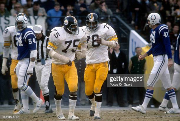 Defensive End Dwight White of the Pittsburgh Steelers is coming off the field with teammate Joe Greene December 19 1976 during an NFL football game...