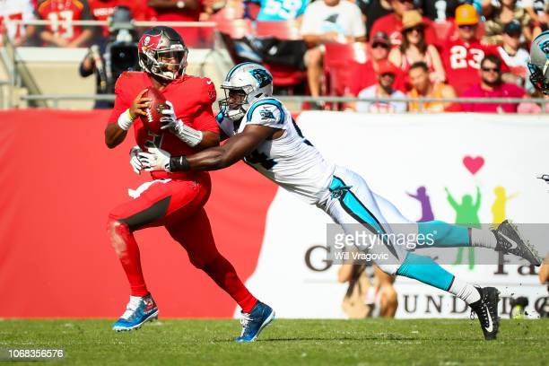 Defensive end Efe Obada of the Carolina Panthers sacks quarterback Jameis Winston of the Tampa Bay Buccaneers in the first half of the game at...