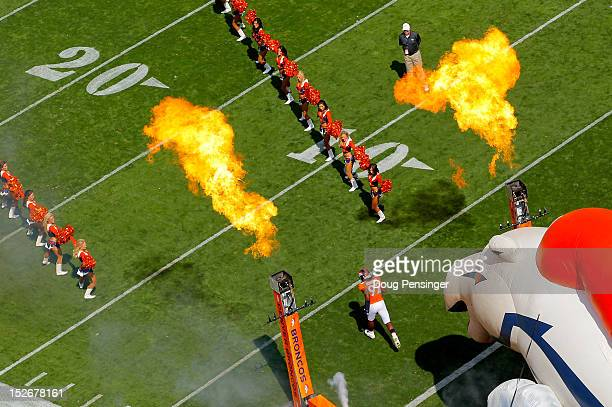 Defensive end Elvis Dumervil of the Denver Broncos is introduced prior to facing the Houston Texans the Houston Texans at Sports Authority Field at...