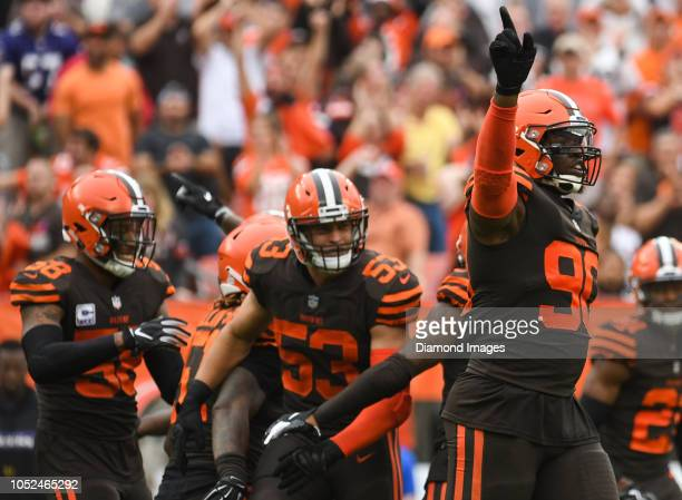 Defensive end Emmanuel Ogbah of the Cleveland Browns celebrates a fumble recovery in the third quarter of a game against the Baltimore Ravens on...