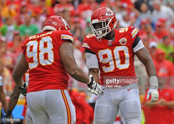 Defensive end Emmanuel Ogbah of the Kansas City Chiefs celebrates with nose tackle Xavier Williams after a sack against the Baltimore Ravens during...