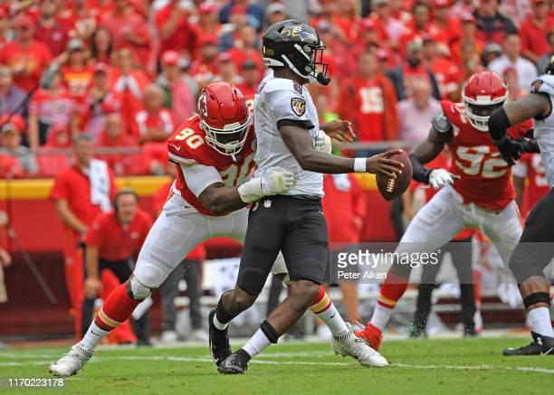 Defensive end Emmanuel Ogbah of the Kansas City Chiefs sacks quarterback Lamar Jackson of the Baltimore Ravens during the second half at Arrowhead...